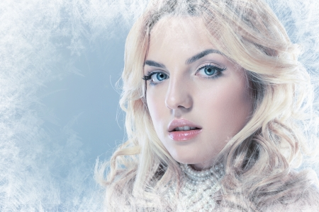 winter woman: ice-queen. Young winter woman in creative image with silver blue artistic make-up and perfect hairstyle.