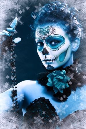 day of the dead: winter make up sugar skull beautiful model with ice. Santa Muerte concept.