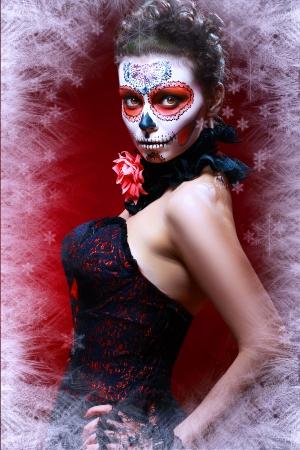 winter make up sugar skull beautiful model with ice. Santa Muerte concept. photo