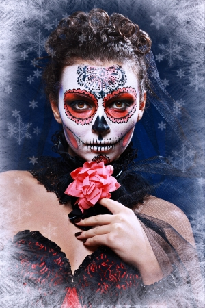 winter woman make up sugar skull beautiful model with ice. Santa Muerte concept. photo