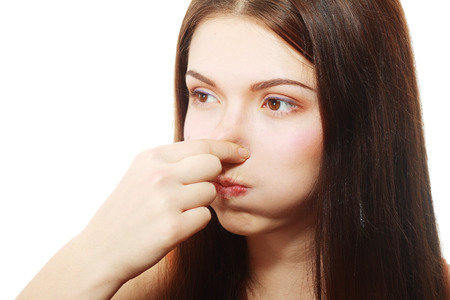 stinking: Young Woman Holding her Nose smelling something stinking