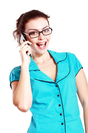 Portrait of happy smiling woman making call in eyeglasses dressed in a blue blouse photo