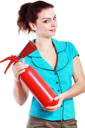 Beautiful Business woman in holding fire extinguisher photo
