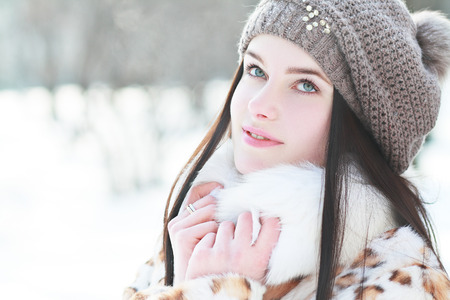 cold weather: Outdoor portrait of young pretty beautiful woman in cold sunny winter weather in park. Sensual brunette posing and having fun Stock Photo
