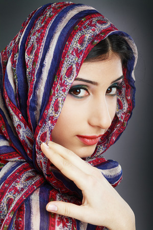 Beautiful Arabic woman wearing head scarf photo