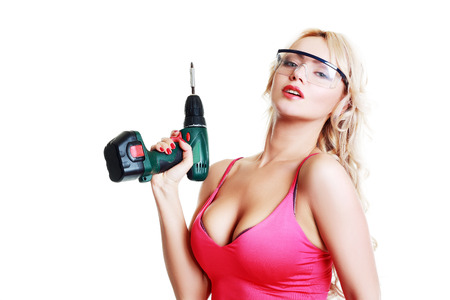 High fashion glamour blondy model in pink top and safe eyeglasses with a screw gun photo
