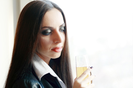 desperation: Alone young woman in depression drink alcohol