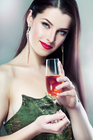 young woman in green dress hold a glass of champagne retro colors photo