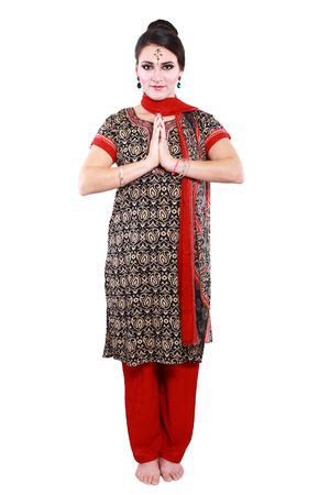 Indian woman in traditional clothing greeting namaste photo