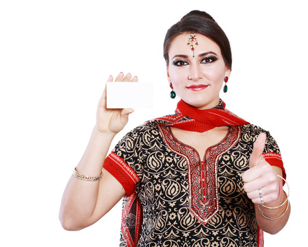 Happy indian woman hold blank business card or credit card  photo