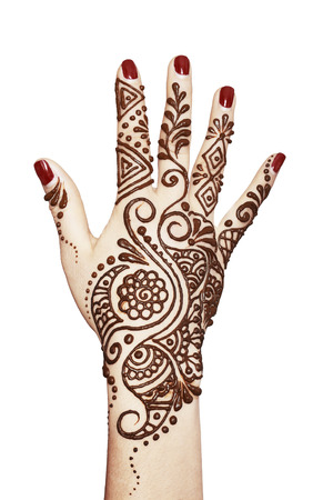 color tribal tattoo: Image detail of henna being applied to hand isolated over whit