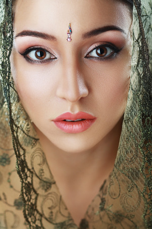 Indian beauty face close up perfect make up. Series. young beautiful brunette in traditional national dress Stock Photo