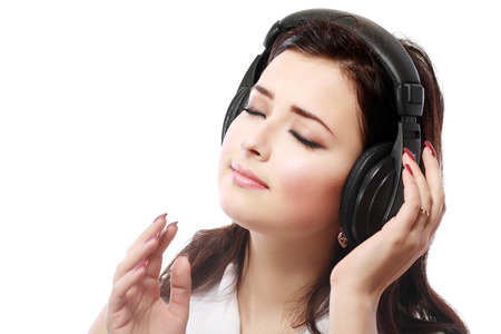 Young woman with headphones listening music close up face photo