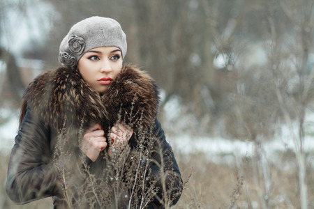 covered fields: worried woman in depression in snow covered fields landscape  Stock Photo