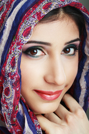 Beautiful Arabic woman wearing head scarf, stylish female portrait photo