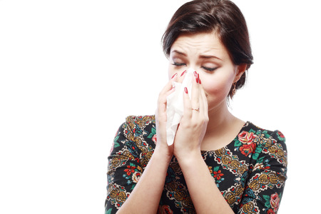 Close-up portrait of a teen woman with allergy or cold photo