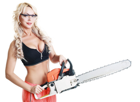 beautiful hot blond woman hold a chainsaw over white background isolated photo