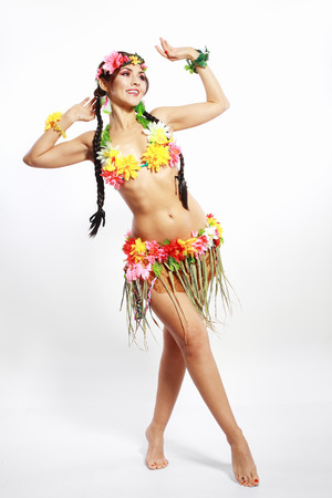 Beautiful exotic girl with Hawaiian accessories inviting and smiling photo