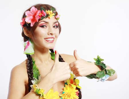 Beautiful exotic girl with Hawaiian accessories Excited woman show thumbs up in gesture photo