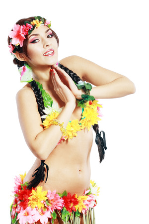 Beautiful exotic girl with Hawaiian accessories posing over white photo