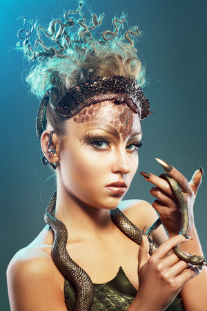 medusa: Gorgon medusa. Young woman with creative fantasy hairstyle and make up