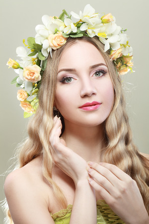 spring beauty portrait girl with wreath of flowers photo
