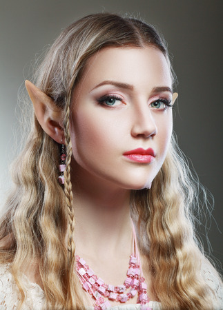 Stylish portrait of a beautiful young girl elf princess magical photo