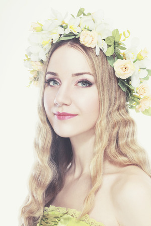 pastel shades: spring beauty portrait girl with wreath of flowers , pastel shades  Stock Photo