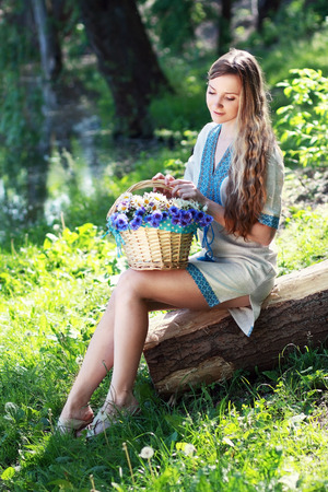 Portrait of beautiful romantic ukrainian woman in forest  Stock Photo