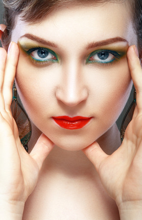 ceremonial make up: Close-up of beautiful female face with colorful make-up and lips