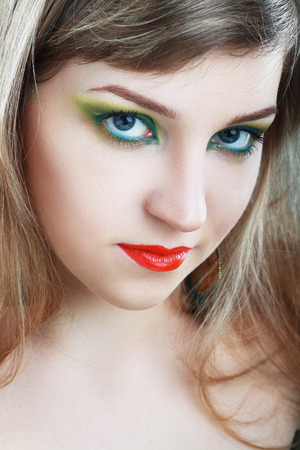 ceremonial make up: Close-up of beautiful female face with colorful make-up and lips Stock Photo