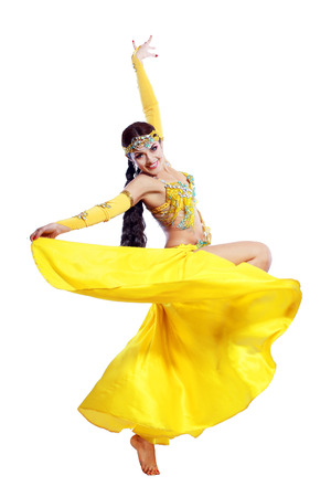 Beautiful young belly dancer in action photo