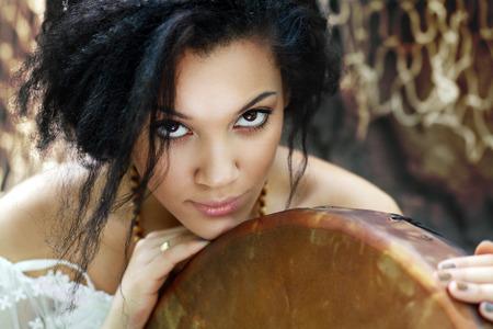 Portrait of shaman woman with a tambourine close up Archivio Fotografico