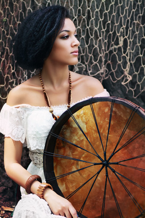 female shaman: Portrait of shaman woman with a tambourine in the forest  Stock Photo