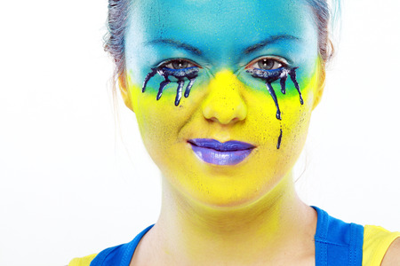 crazy color face art women portrait with yellow and blue as flag of Urkaine photo