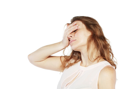woman hold her hand on her eyes feeling a pain headache