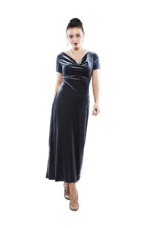 velvet dress: Full length of cute female fashion model posing in velvet dress