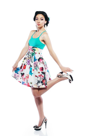 exquisiteness: Fashion Style. Happy Young Shopper in Contrast Flower Print Skirt. Movement