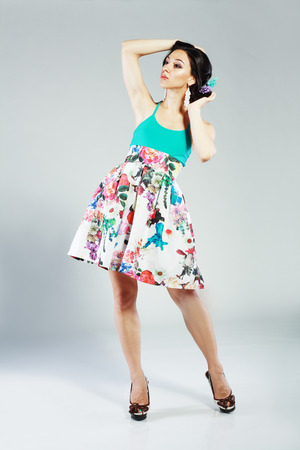 Fashion Style. Happy Young Shopper in Contrast Flower Print Skirt. Movement