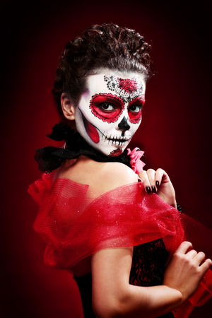 gothic girl: halloween make up sugar skull beautiful model with perfect hairstyle. Santa Muerte concept.