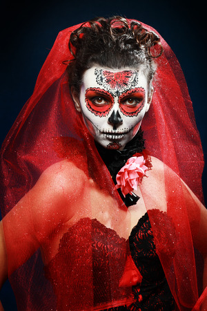 halloween make up sugar skull beautiful model with perfect hairstyle. Santa Muerte concept. photo