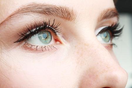 extreme closeup of beautiful womanish eye with glamorous makeup macro