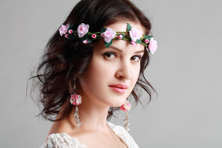 fashion woman Young woman in white with wreath of flowers photo