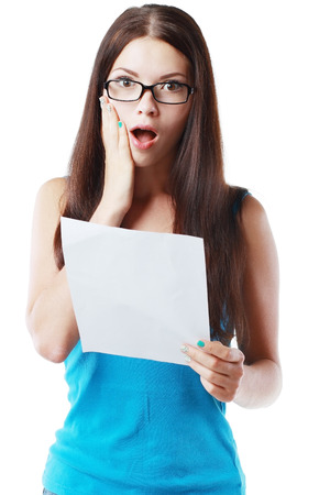 brunette young woman shocked realizes that something amazing or bad happened reading a white letter or document photo