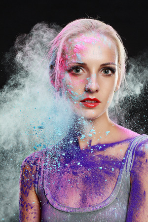 colored powder: girl with colored powder exploding around her and into the background.