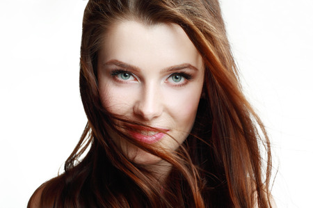 Beautiful woman with fluttering hair looking at camera. photo