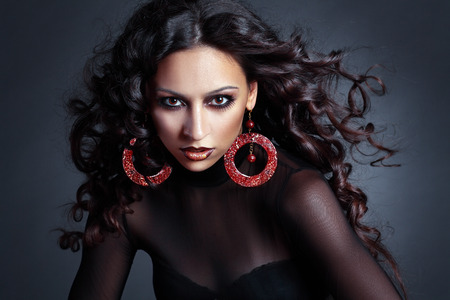 high fashion model: beautiful female high fashion model with flying curly hair