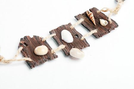 rustical: vintage rustical boho handmade wooden necklace over white background