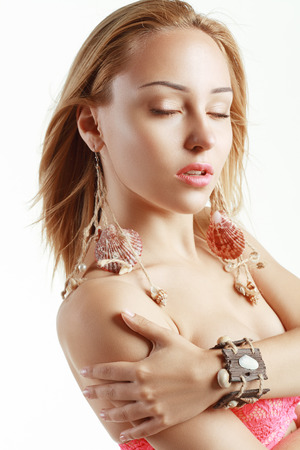 Peculiar Woman with Shell earrings and wooden bracelet