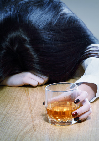 intoxicated: Young crying woman in depression drink drinking alcohol